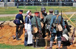 A nurse and soldiers. Mincer Nivelle battle reenactment. MOSCOW - JUNE 08, 2014: A nurse and soldiers. Historical reenactment of Mincer Nivelle battle held in Royalty Free Stock Photos