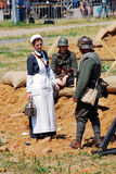 A nurse speaks to soldiers. MOSCOW - JUNE 08, 2014: A nurse speaks to soldiers. Historical reenactment of Mincer Nivelle battle held in 1917, the largest battle Stock Images