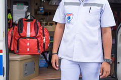 Nurse standing beside ambulance prepare for helping people Royalty Free Stock Photo