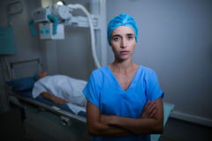 Nurse standing with arms crossed in x-ray room Stock Photos