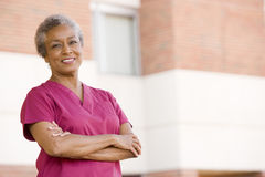 Nurse Standing Outside A Hospital Royalty Free Stock Photo