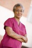 Nurse Standing Outside A Hospital Stock Image