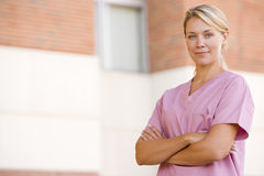 Nurse Standing Outside A Hospital. Looking at camera stock photos