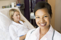 Nurse Standing In Patients Room. Smiling to Camera royalty free stock photo