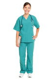 Nurse standing smiling. Nurse or young doctor standing smiling on white background in full body. Woman medical professional in green scrubs smiling happy. Mixed Royalty Free Stock Photo