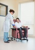 Nurse Starting Chemo Treatment Royalty Free Stock Image