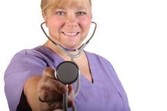 Nurse with Stethoscope. Caucasian blonde blue eyed nurse or doctor holding a stethoscope, isolated royalty free stock photo