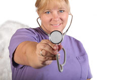 Nurse with stethoscope. Portrait of a nurse holding a stethoscope royalty free stock photography