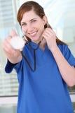 Nurse with Stethoscope at Hospital Royalty Free Stock Photos