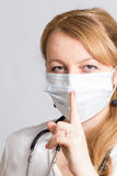 Nurse with stethoscope and a protective mask asks silence Royalty Free Stock Photo