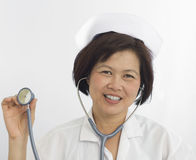 Nurse with stethoscope and smiling at camera Stock Image
