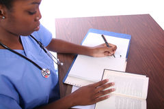 Nurse or Student. Studying African American Woman royalty free stock photo