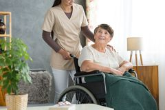 Happy elderly woman in wheelchair Royalty Free Stock Photography