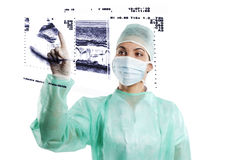 Nurse in surgery dress on touch screen Stock Images