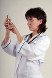 Nurse with syringe royalty free stock image