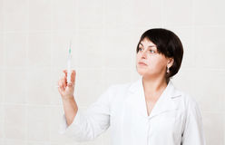 Nurse with syringe Royalty Free Stock Photos