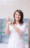 Nurse with syringe Stock Photo