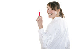 Nurse with a syringe filled with red liquid Stock Photo
