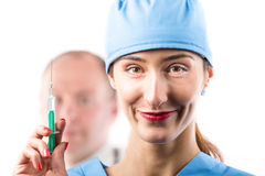 A nurse with syringe in her hand. Stock Photos