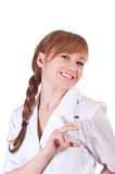 Nurse with syringe at white background. Royalty Free Stock Image