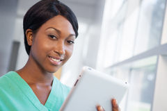 Nurse with tablet computer Royalty Free Stock Photo