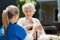 Free Nurse Takes Care Of Old Patient Stock Images - 125353194