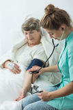Nurse taking blood pressure Royalty Free Stock Photo