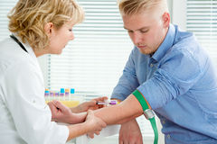 Nurse taking blood sample. From patient at the doctors office royalty free stock photos