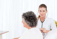 Nurse taking care of her patient Stock Photography