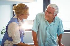Nurse taking care of a senior man Royalty Free Stock Image