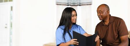 Nurse Taking Care of Senior Stock Images