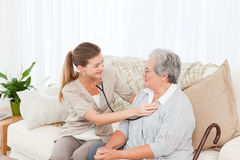 Nurse taking the heartbeat of her patient Royalty Free Stock Photography