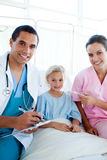 A nurse taking her patient's temperature Royalty Free Stock Photography