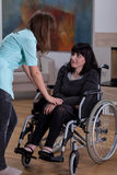Nurse talking with disabled woman royalty free stock photo