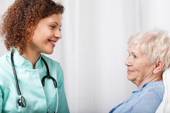 Nurse talking with elderly woman Stock Photos