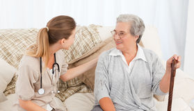 Nurse talking with her patient Royalty Free Stock Images
