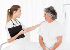 Nurse talking with her patient stock photos