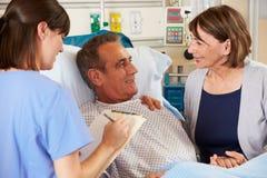Nurse Talking To Couple On Ward Stock Images