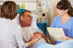 Nurse Talking To Couple On Ward Stock Photography
