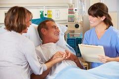 Nurse Talking To Couple On Ward Royalty Free Stock Images