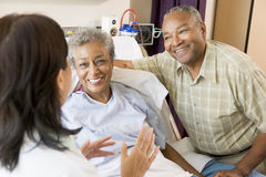 Nurse Talking To Senior Couple Stock Photos