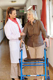 Nurse talking to senior patient Stock Photos