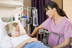 Nurse Talking To Senior Woman Stock Images