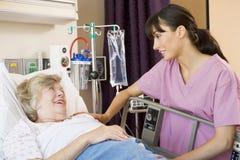 Nurse Talking To Senior Woman Stock Images