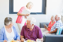 Nurse talking to seniors Royalty Free Stock Photo