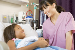 Nurse Talking To Young Patient Royalty Free Stock Image