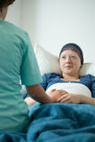 Nurse talking with woman with cancer Stock Photography