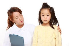 Nurse Talks To A Child Patient Royalty Free Stock Photo
