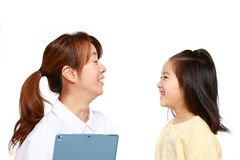 Nurse Talks To A Child Patient Stock Images
