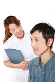 Nurse Talks To Her Patient Royalty Free Stock Photography